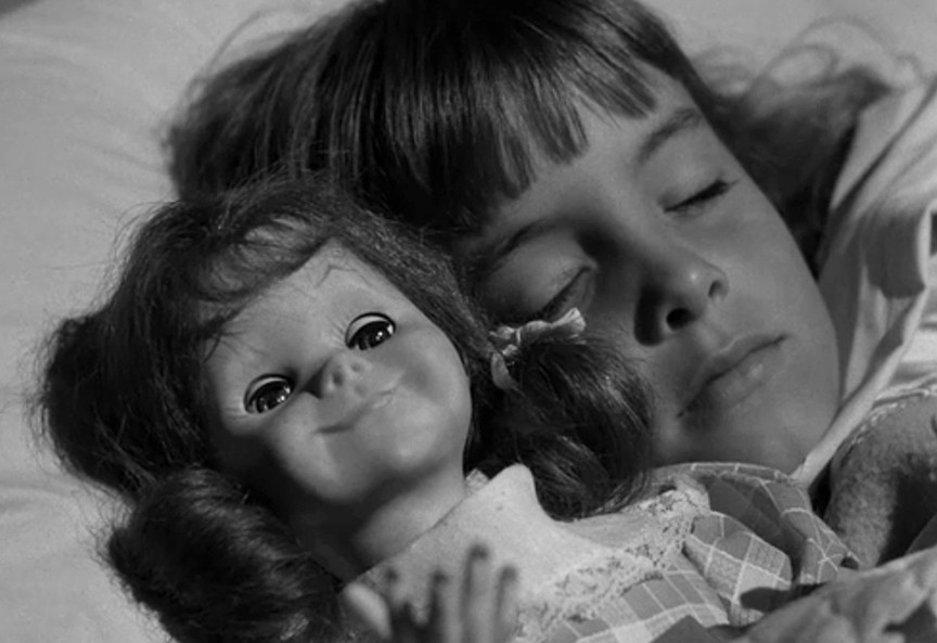 Angelic Christie sleeps with the doll she loves, unaware the doll wants to murder her stepfather.