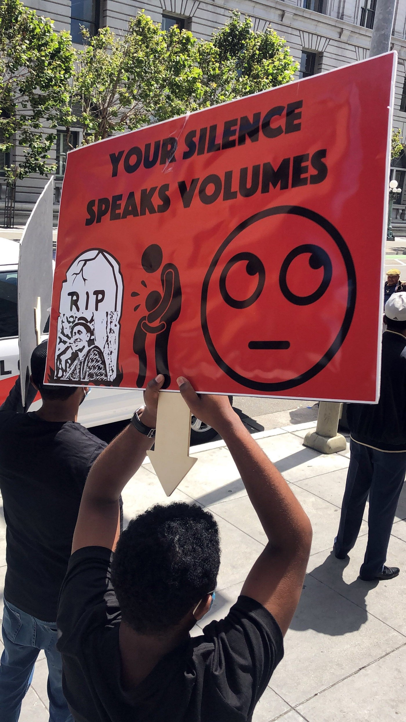 Protesters hold signs in San Francisco in recognition of the worldwide #oromoprotest