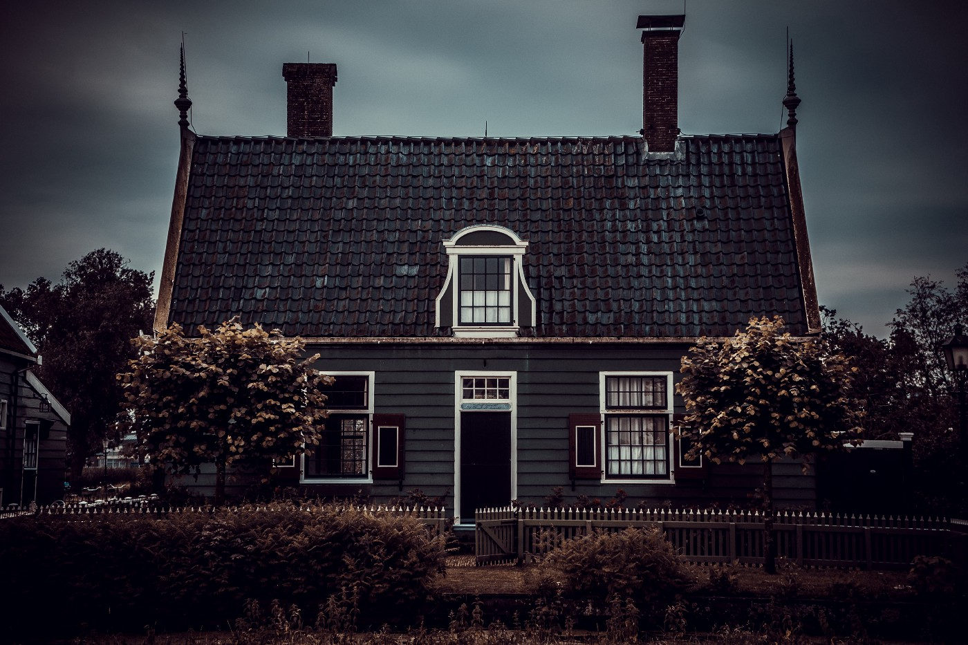 creepy looking house under storm clouds