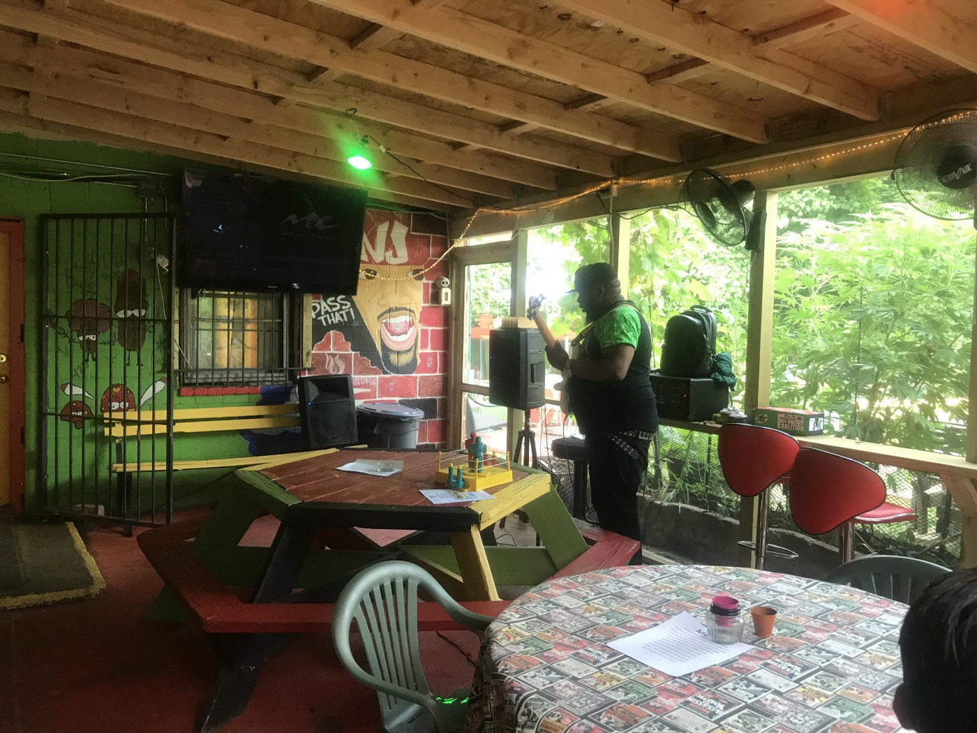 A musician prepares to perform on the back patio of NJ Weedman's Joint.
