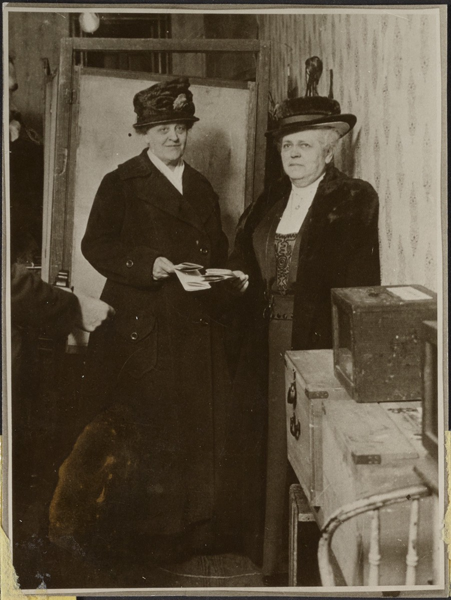 Suffragists Carrie Chapman Catt and Mary Garrett Hay cast their first presidential ballots together, November 2, 1920.