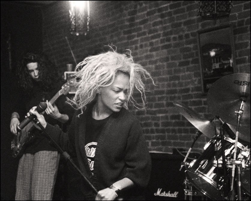 Black and white photo of Tina Bell performing.