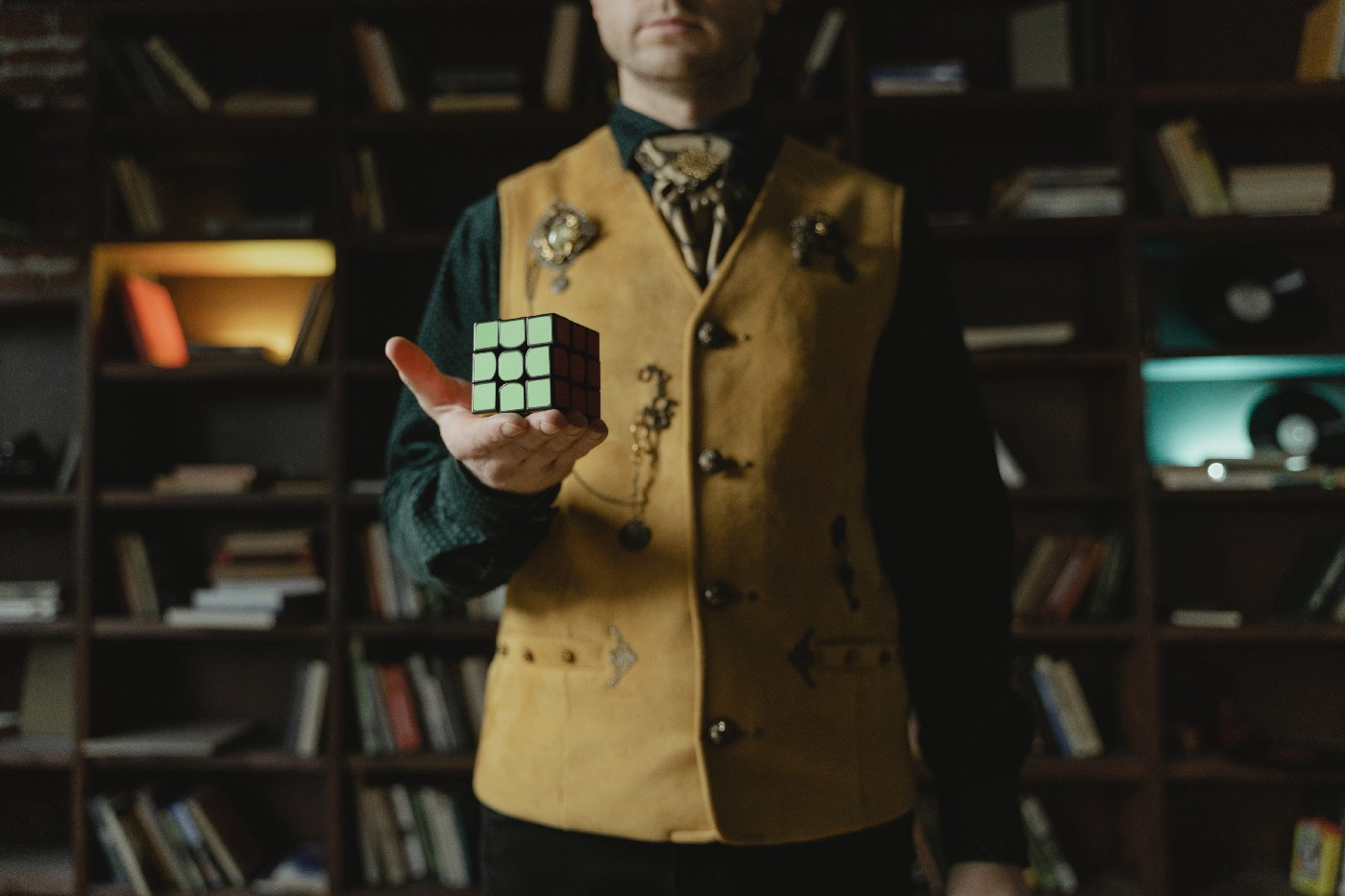 Photo of a man holding a Rubik's cube