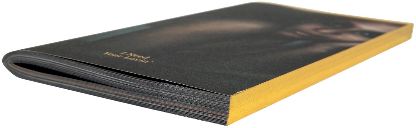 Photograph of the side-on view of the book showing the gold printing on the outside book block edge