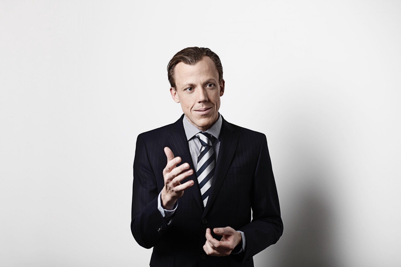 A person in a suit talking.