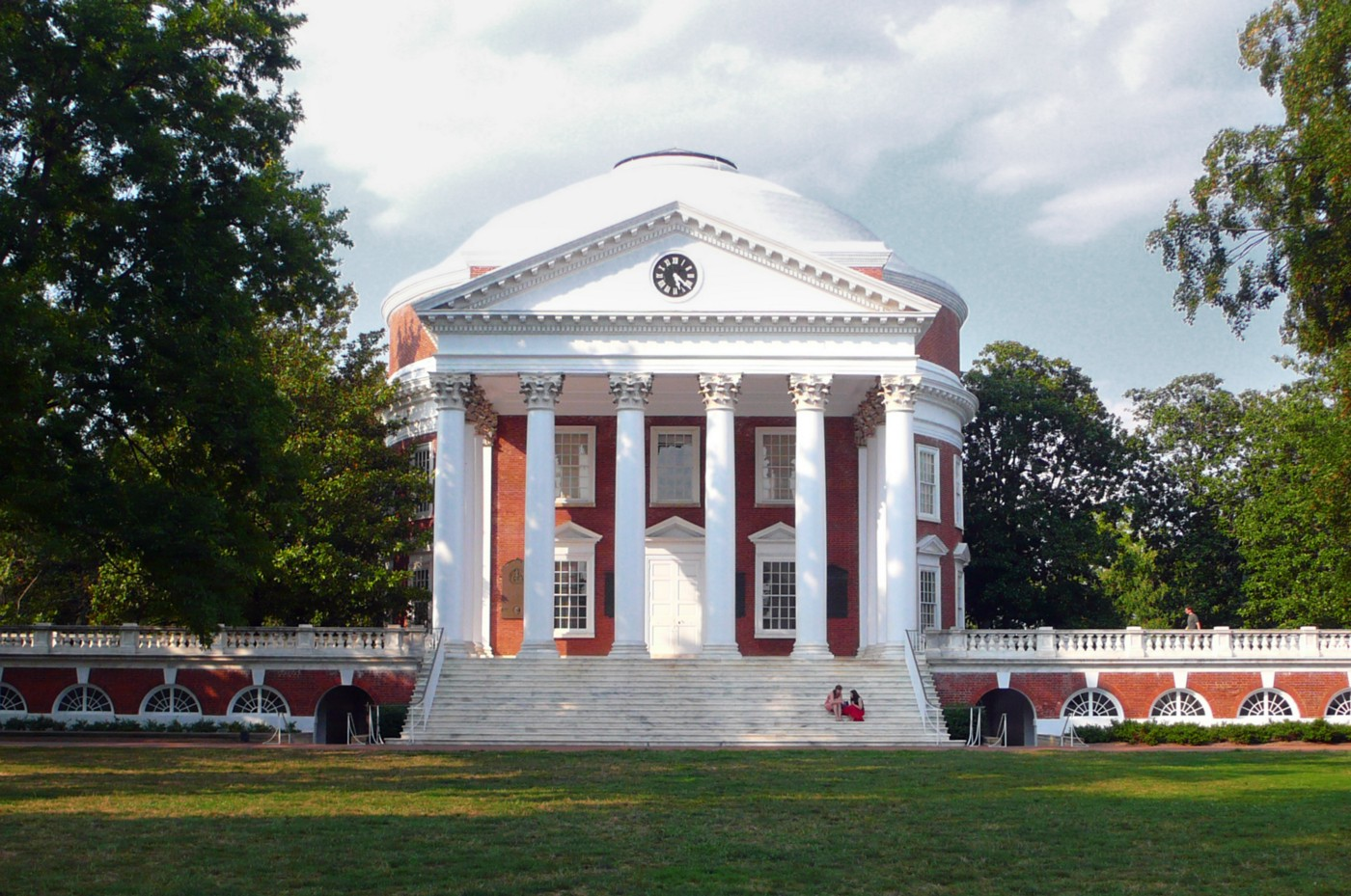 University of Virginia Rotunda with green lawn and blue sky beyond.