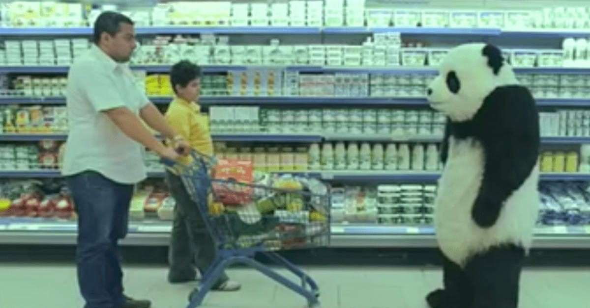 A panda confronts a father and son in the dairy aisle of a grocery store