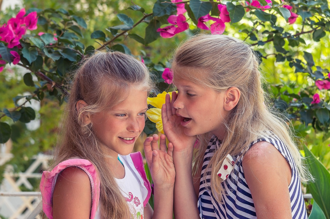 A girl whispering to her sister