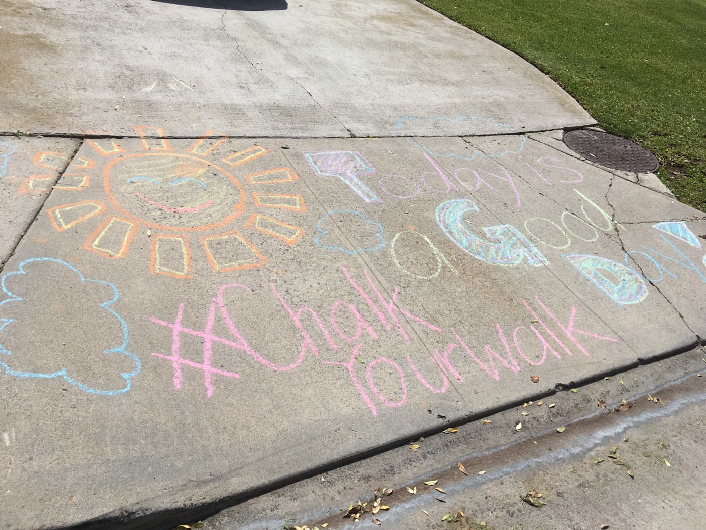 chalk art on sidewalk that reads today is a good day with smiling sun