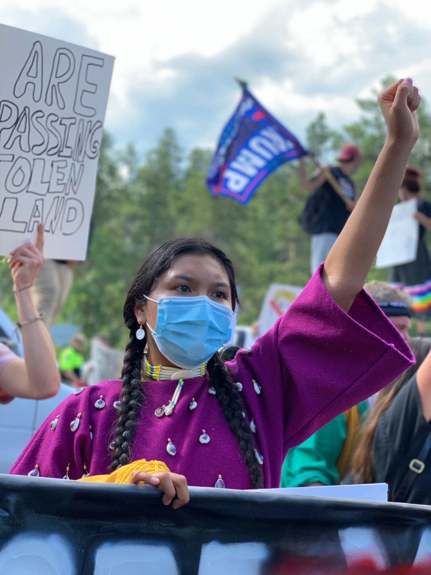 Indigenous woman wearing face mask at a protest in July.