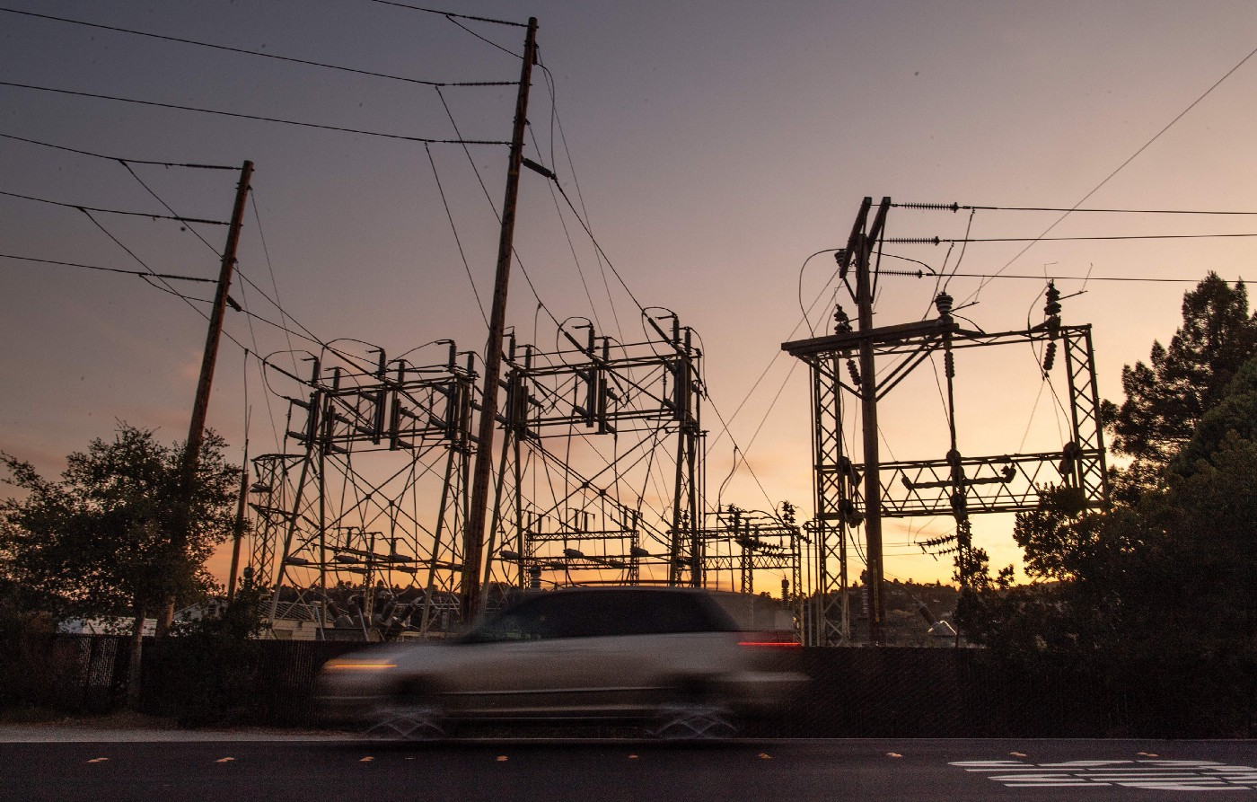 A car drives passed a power station in Mill Valley, California as a statewide blackout continues on October, 10, 2019.