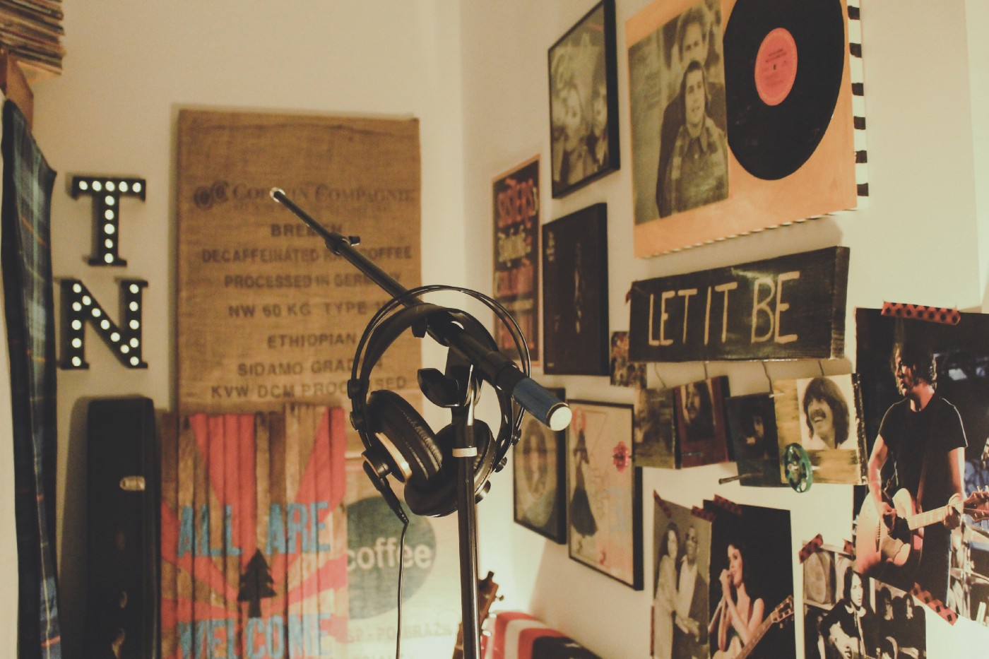 Music equipment in a room full of posters.