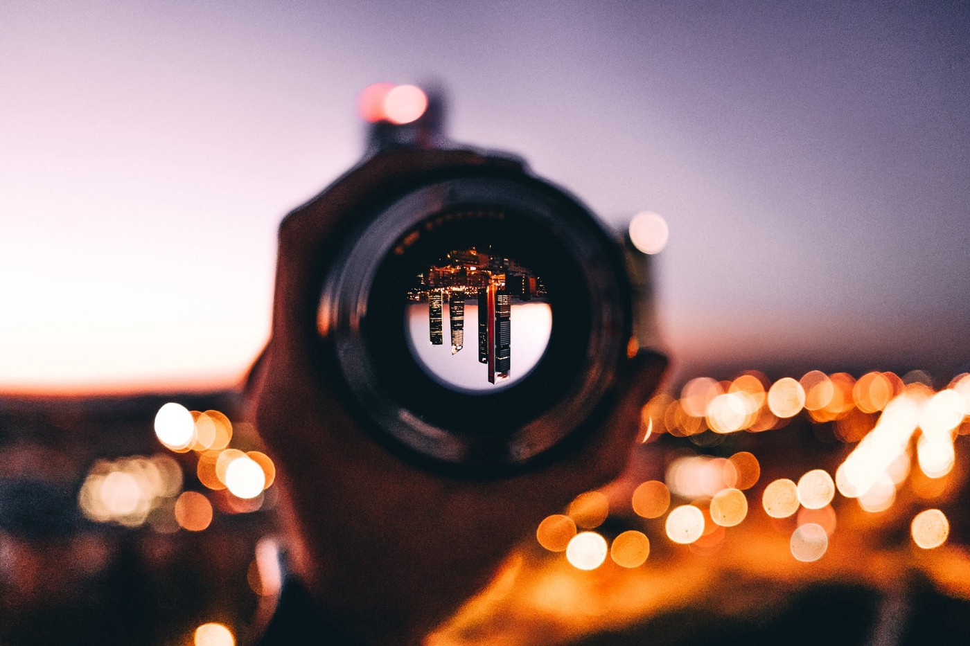 Upside down city view by camera lenses