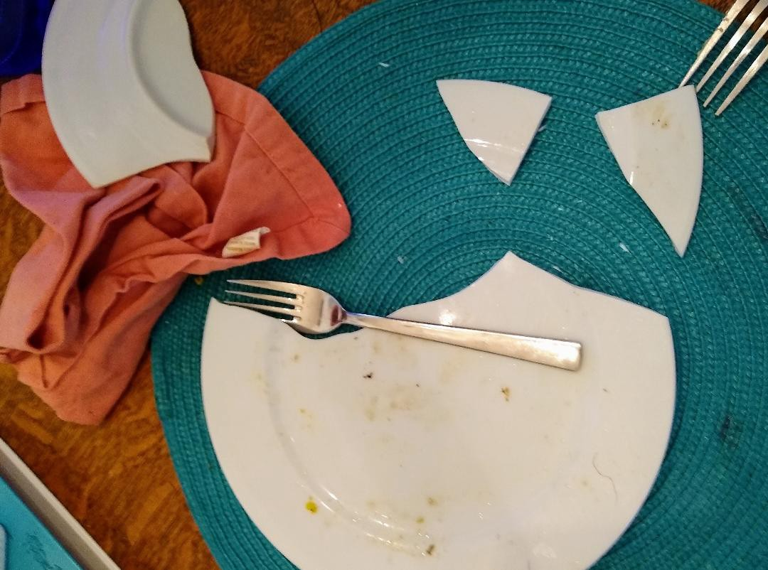 broken plate on placemat