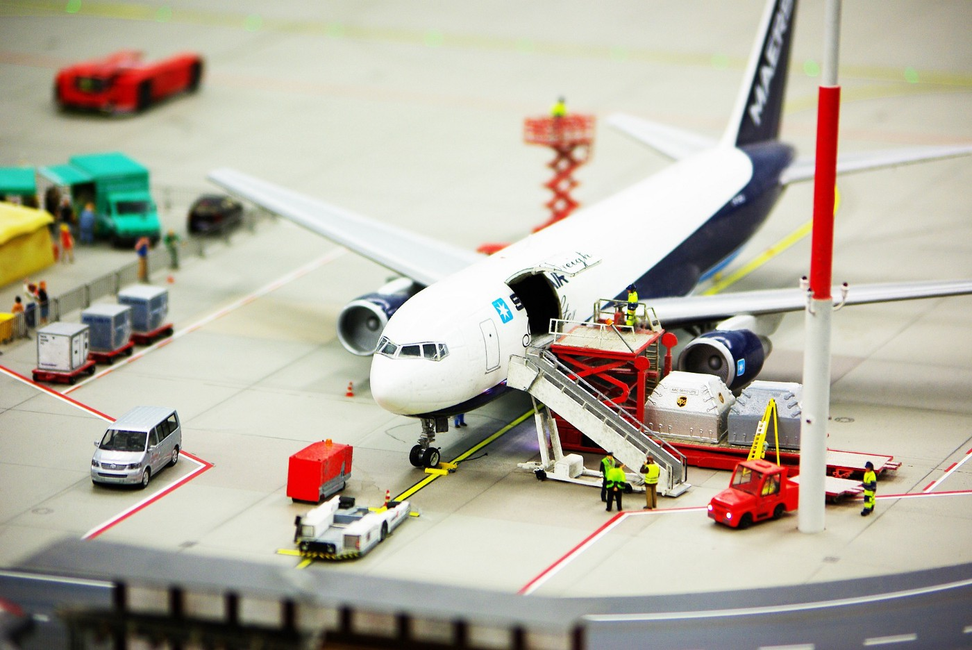 eco-friendly flying with a miniature-sized plane and airport scene