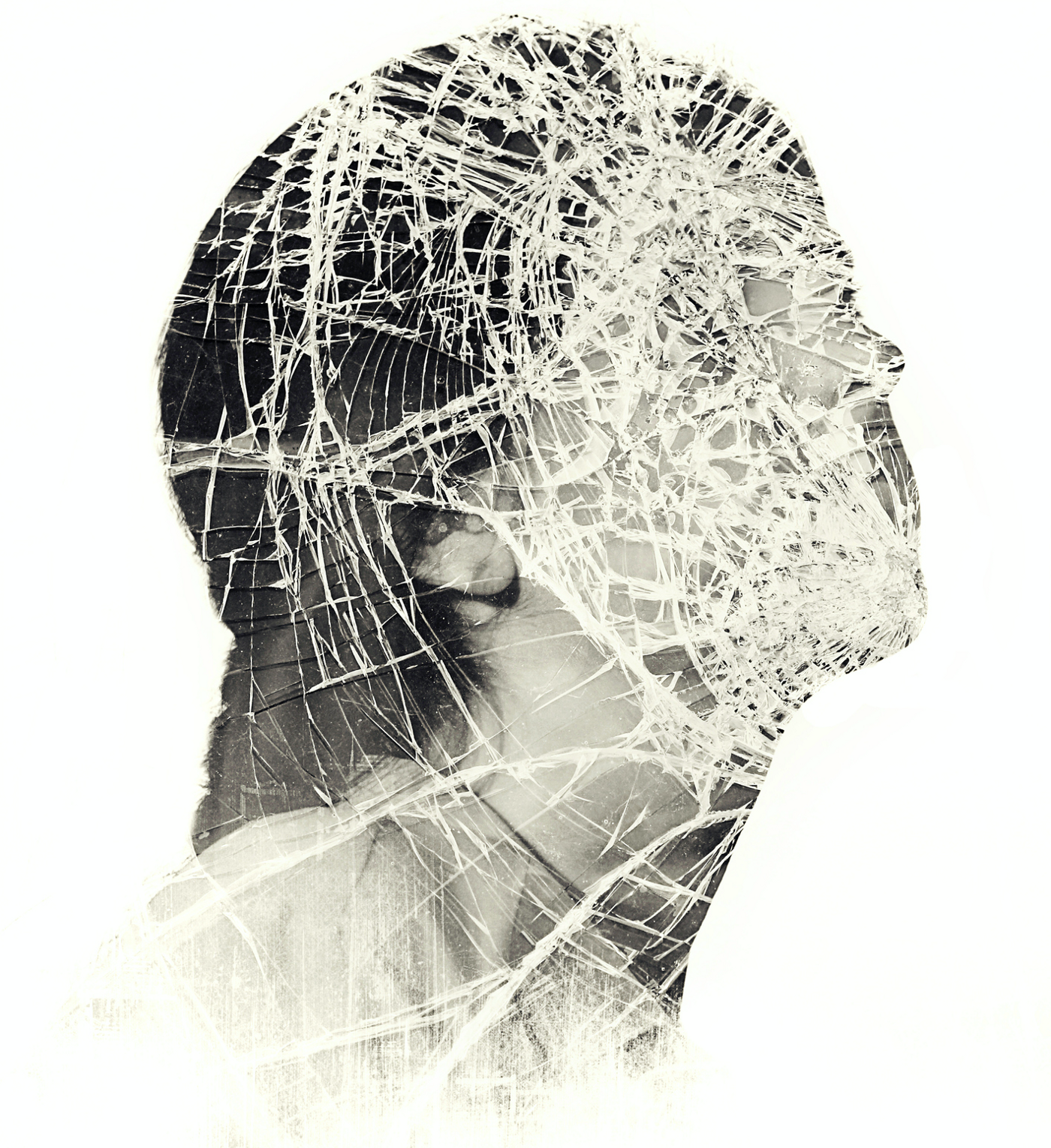 A multiple exposure photo of a woman's face that appears to be shattered.