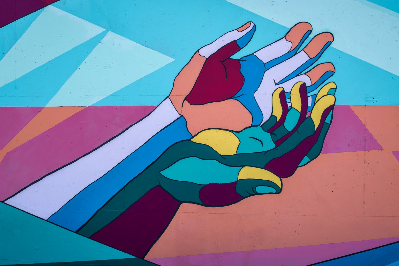 Illustrated hands in many-colored, geometric style, held out with palms up