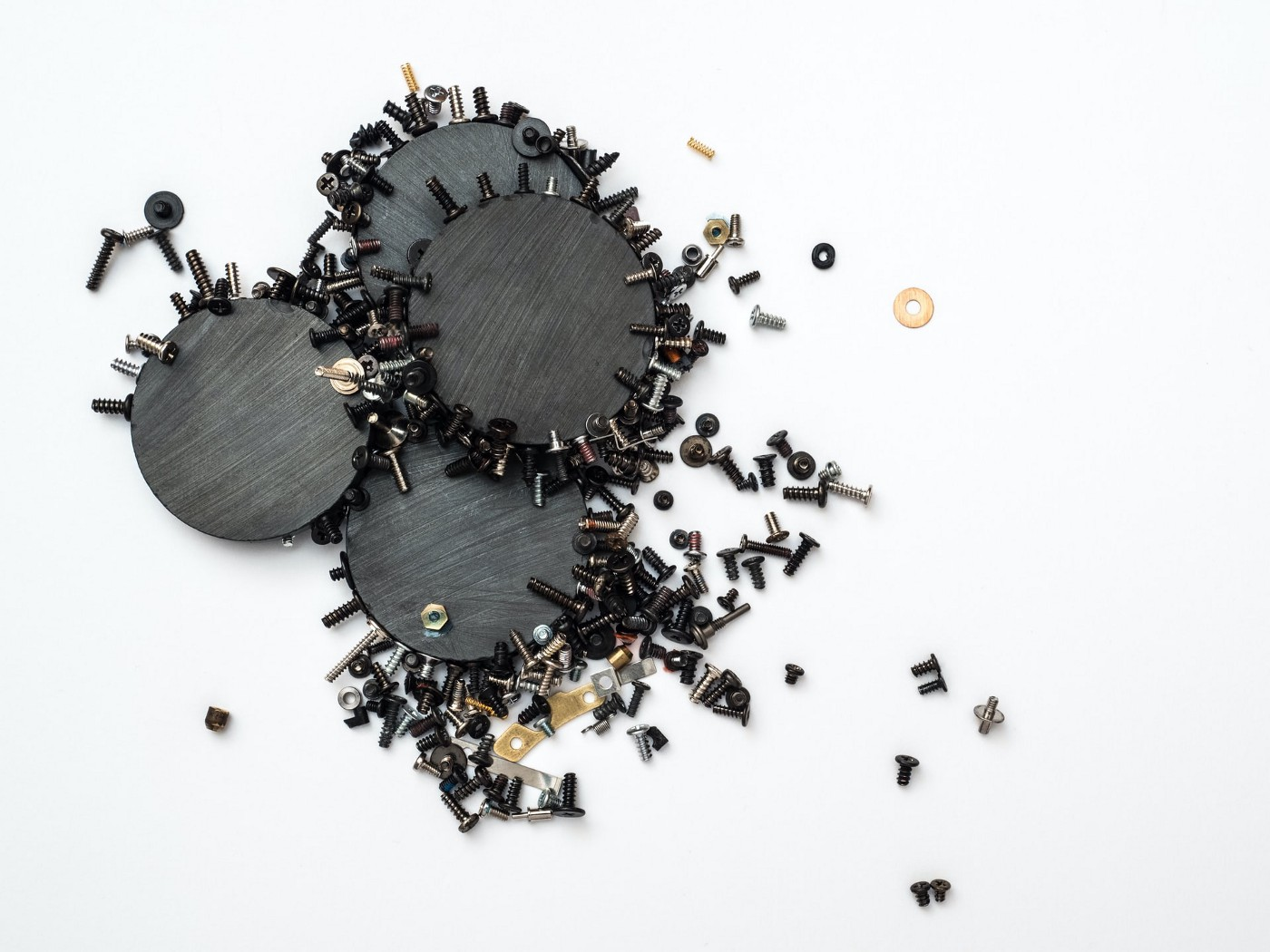 photo of magnets attracting iron particles
