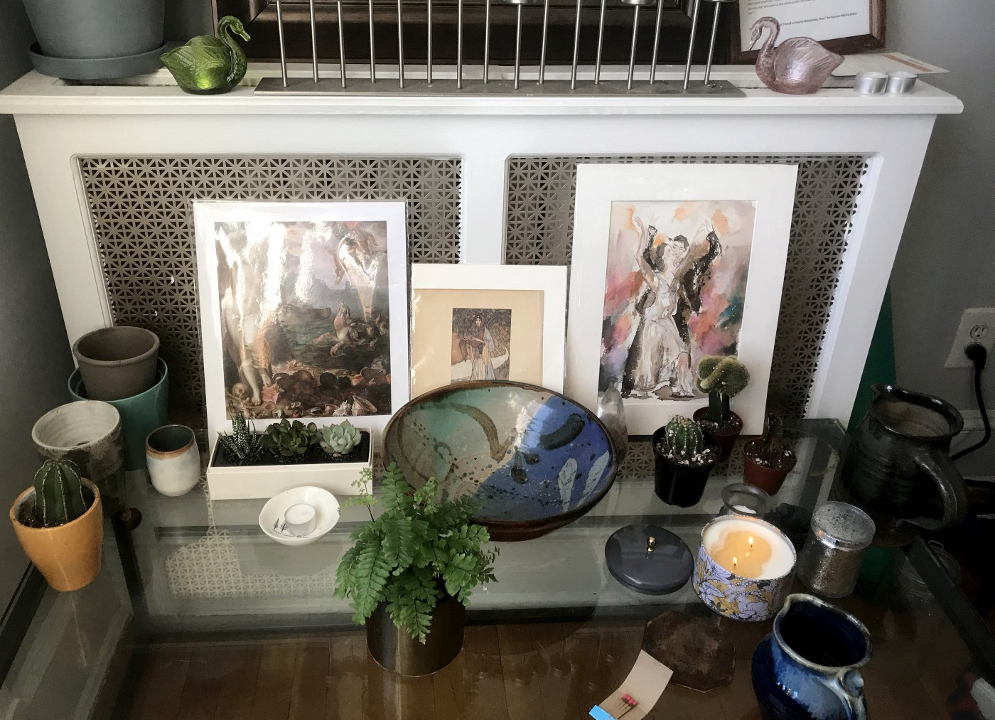 A random assortment of art, plants and candles, created as part of the pandemic. Photo by author.