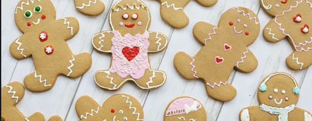 An array of iced gingerbread people on a gray background