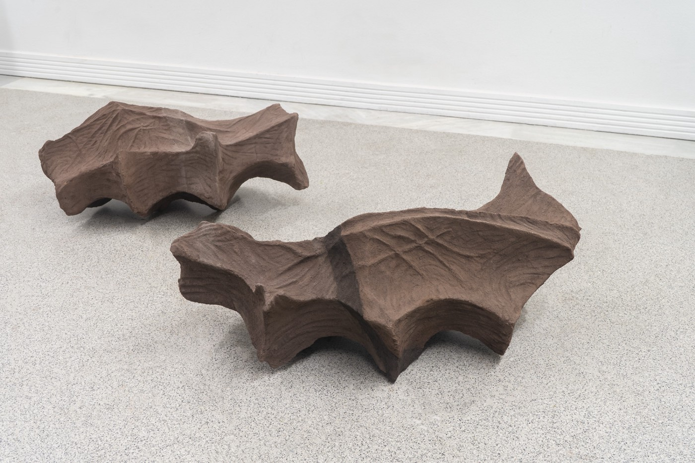 Two sculptures that replicate the space left inside the hand's palm when it closes.
