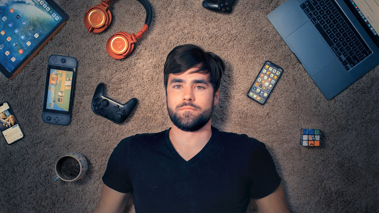Thomas J Frank YouTuber lying on the floor with multiple devices showing Notion Templates.