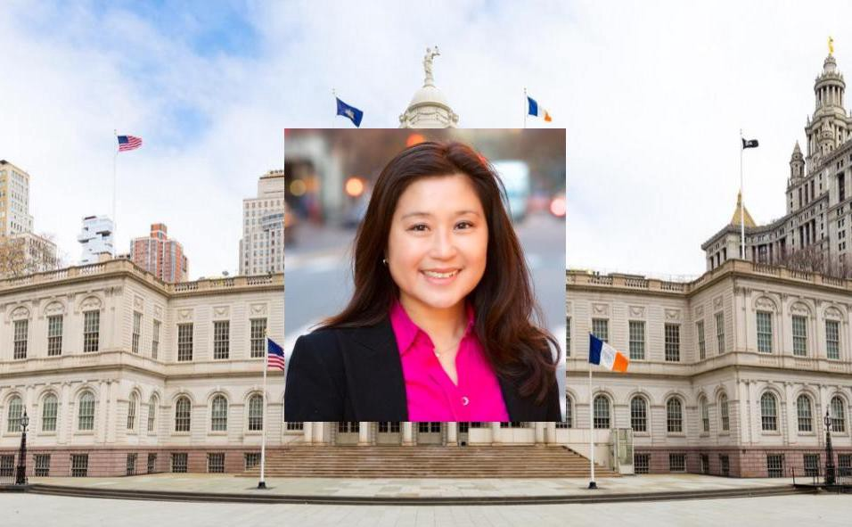 Susan Lee's headshot on top of the NYC City Hall building.