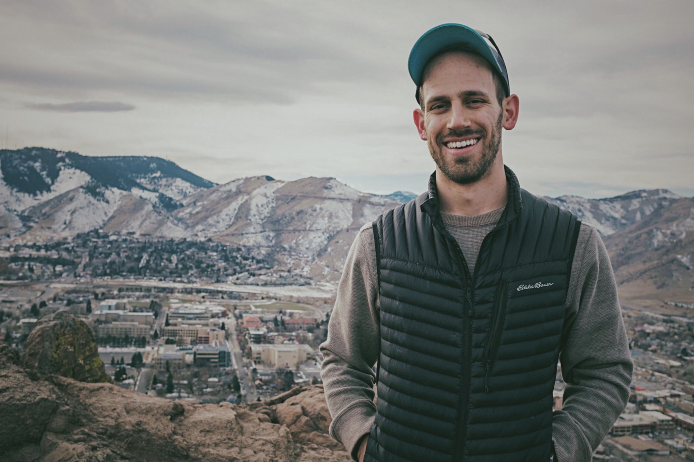 Cameron Naish standing in front of mountains in winter in Golden, Colorado.