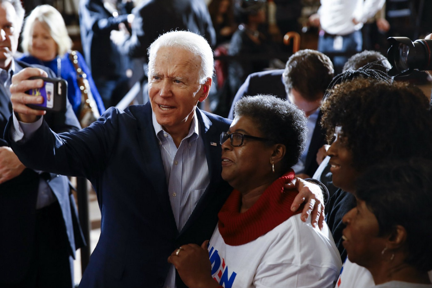 2/26/20 Joe Biden poses with a campaign supporter at an event.