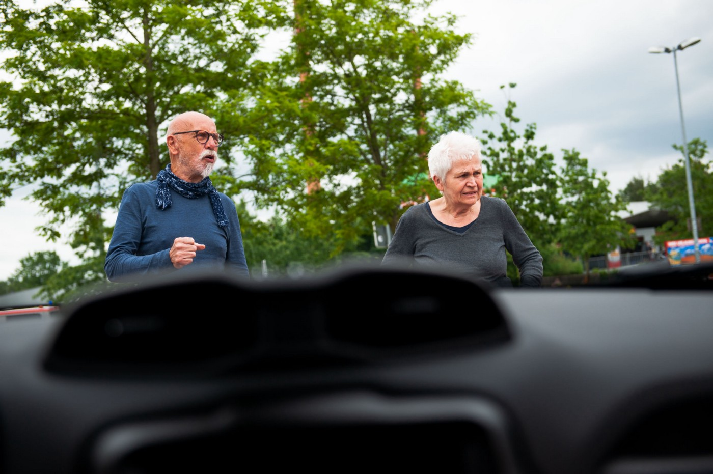 Mom and dad react to a passing car at an autobahn rest stop on the road from Sylt to Oberhausen. Germany, May 28, 2019.