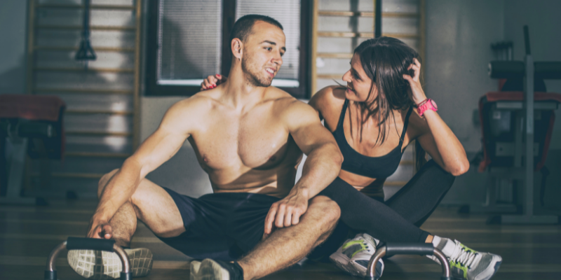 Man and woman sitting on the ground after working out—5 fat loss myths debunked by science