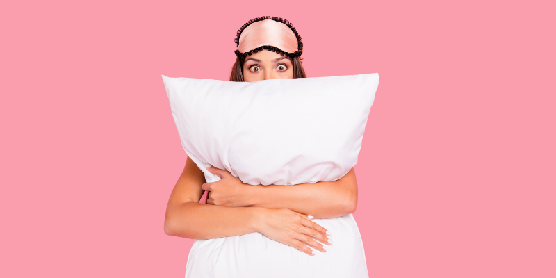 Woman hugging a giant pillow for my article on popular sex dreams
