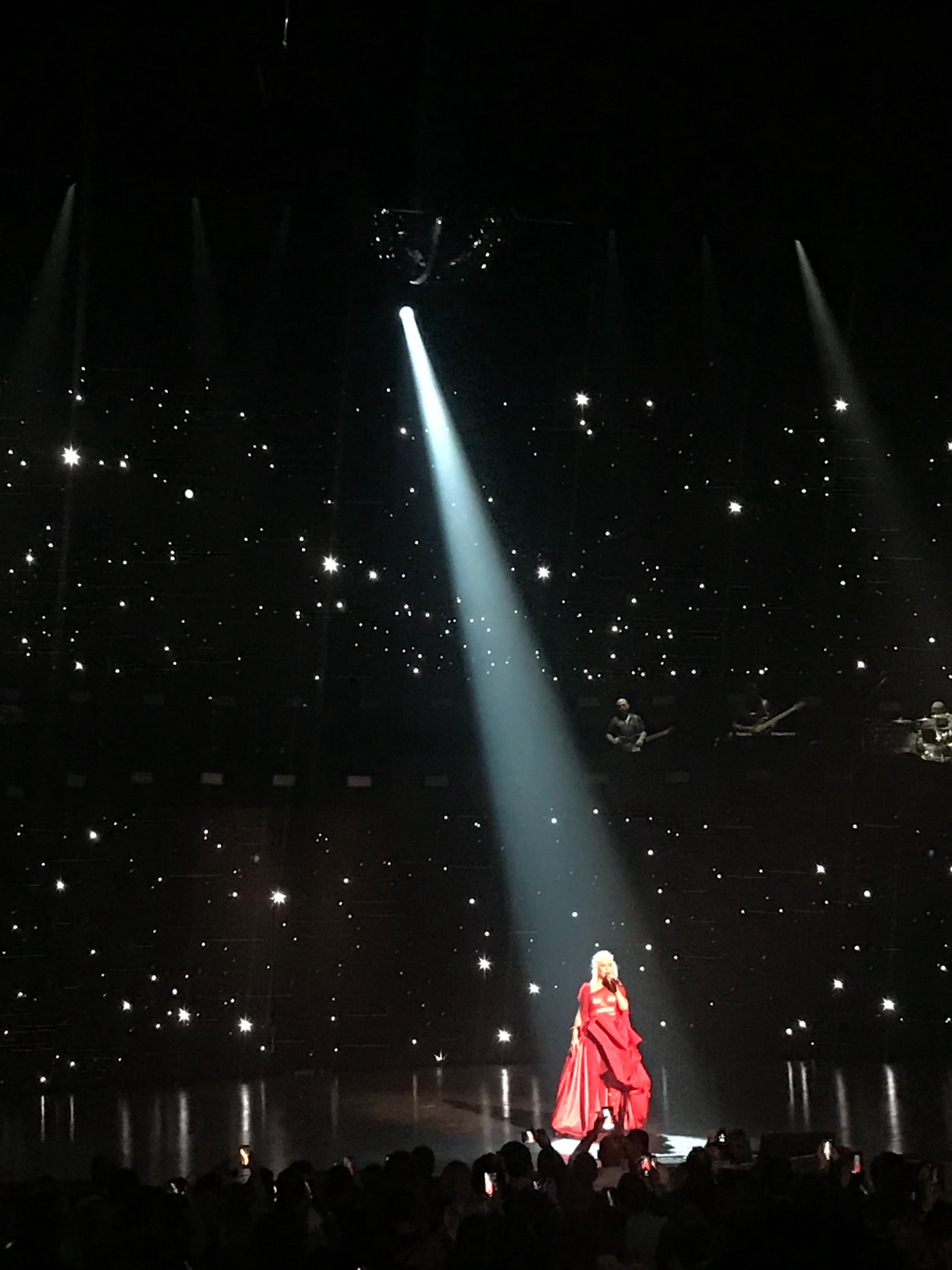 spotlight on a figure dressed in red