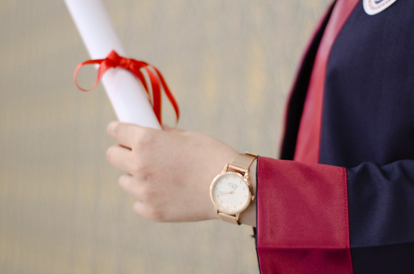 A person holding his degree.