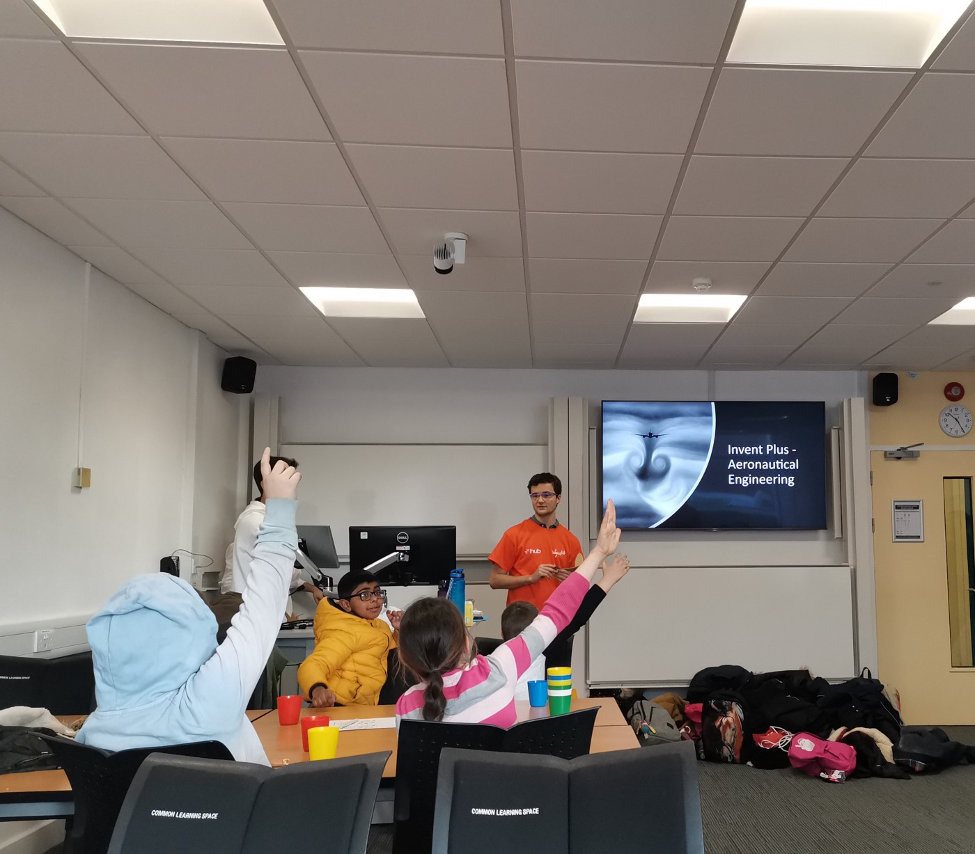 Voluneers delivering an aeronautical engineering session in a classroom