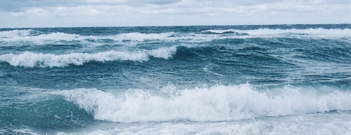 Cold Blue Ocean Waves Rolling Offshore.