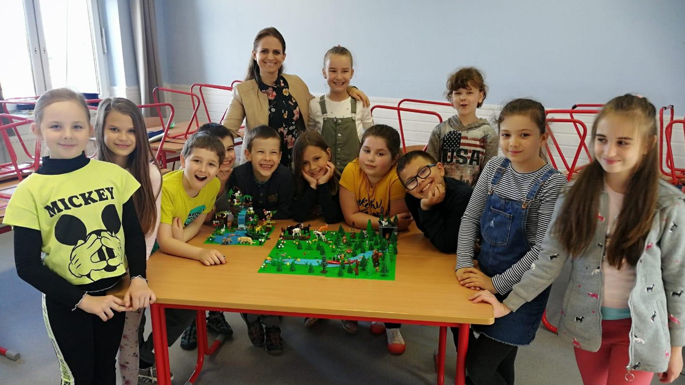 Szabina Sipos with school children in a school in Hungary.
