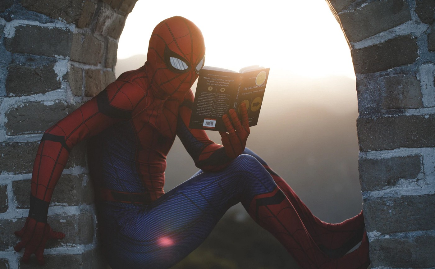 Spider-Man reading a book—Image by Unsplash