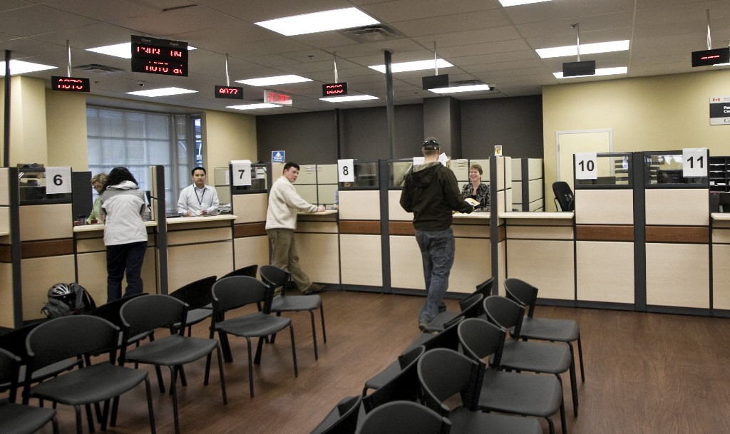 Passport office employees process peoples' applications