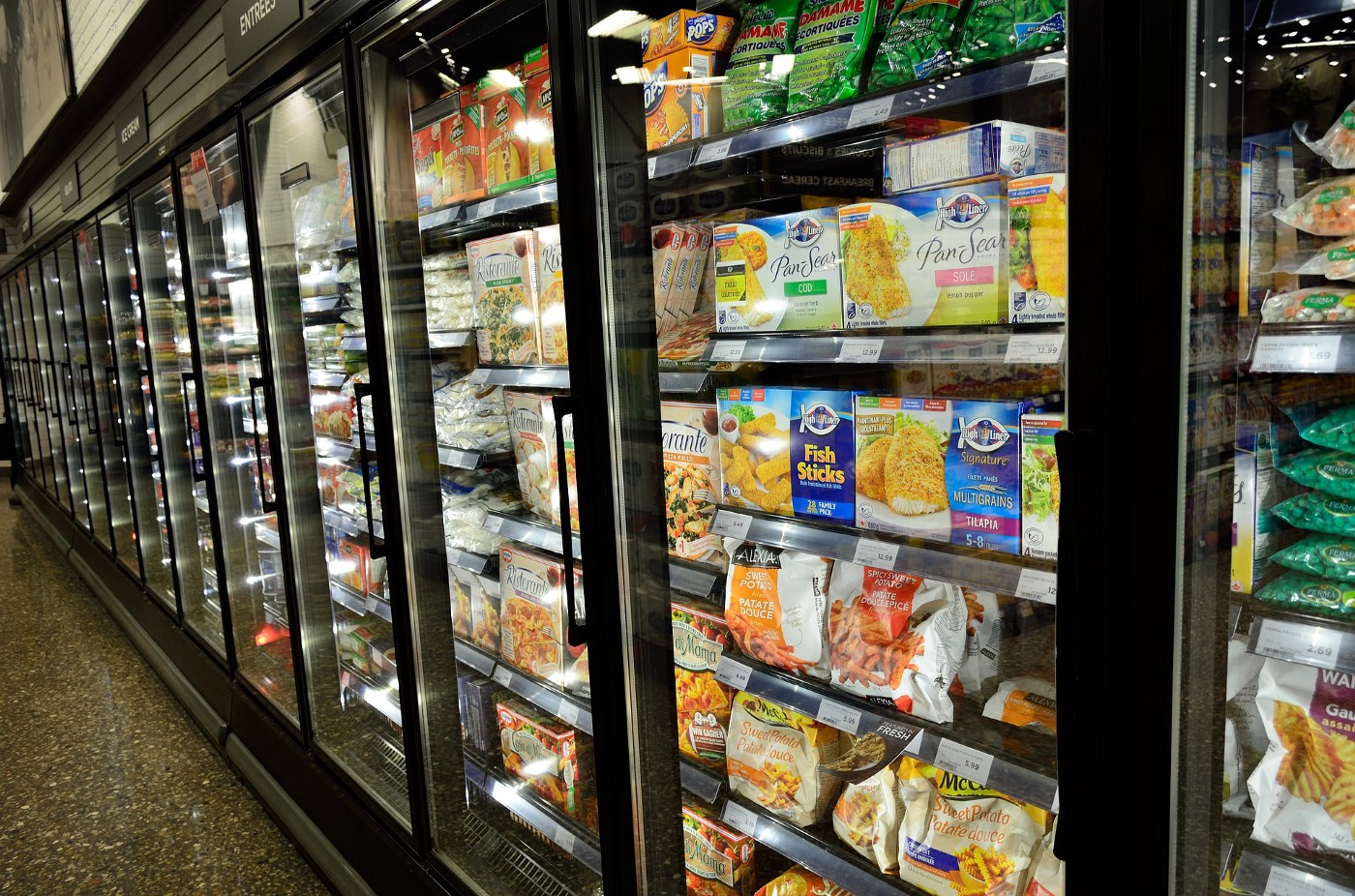 A row of freezers in the grocery store.
