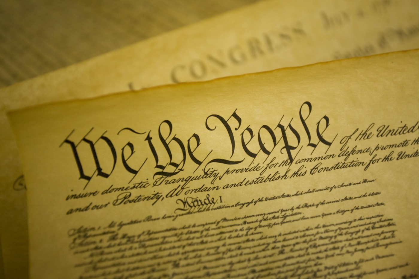 "The Constitution of the United States with ""We the People"" written in a large, ornate font."