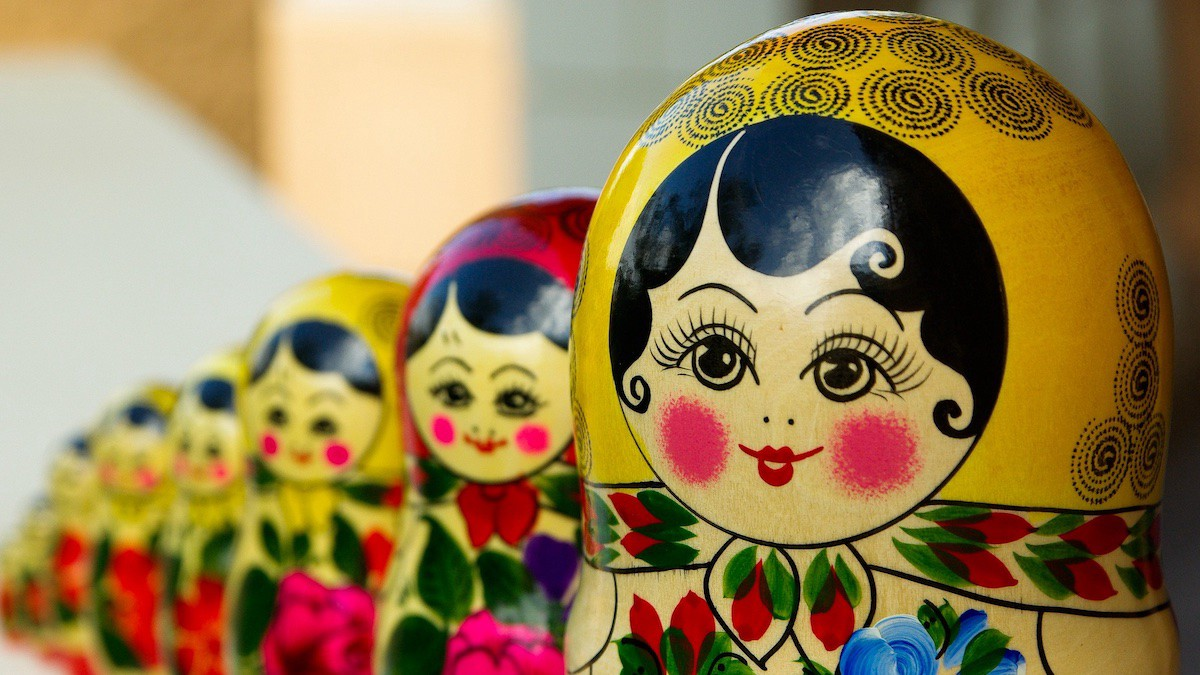 A line of matryoshka dolls, also known as Russian nesting dolls