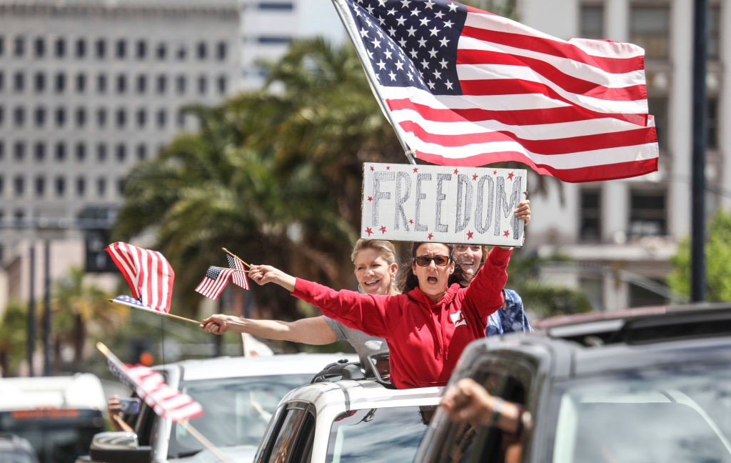 """White protestors at the """"Freedom Rally""""—directly against stay-at-home directives—on April 18, 2020 in San Diego."""
