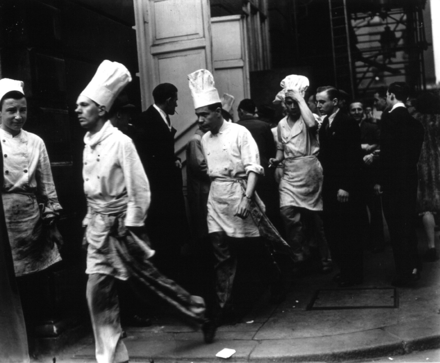 Chefs walk out of the Ritz hotel in London to hear an address by Arthur Lewis MP after which they went on strike.