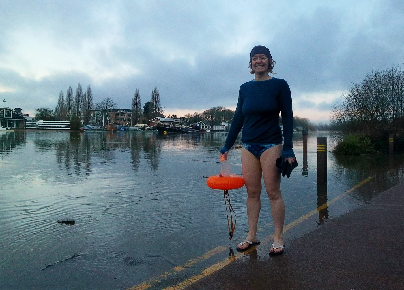 A swimmer next to a river