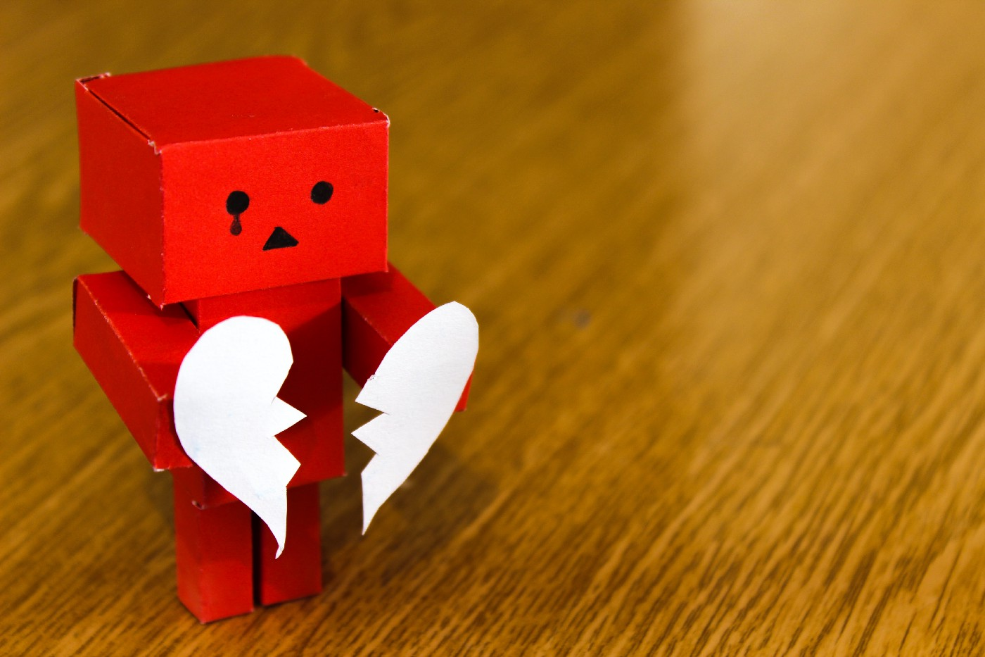 Fear of rejection: a small red robot who is heartbroken
