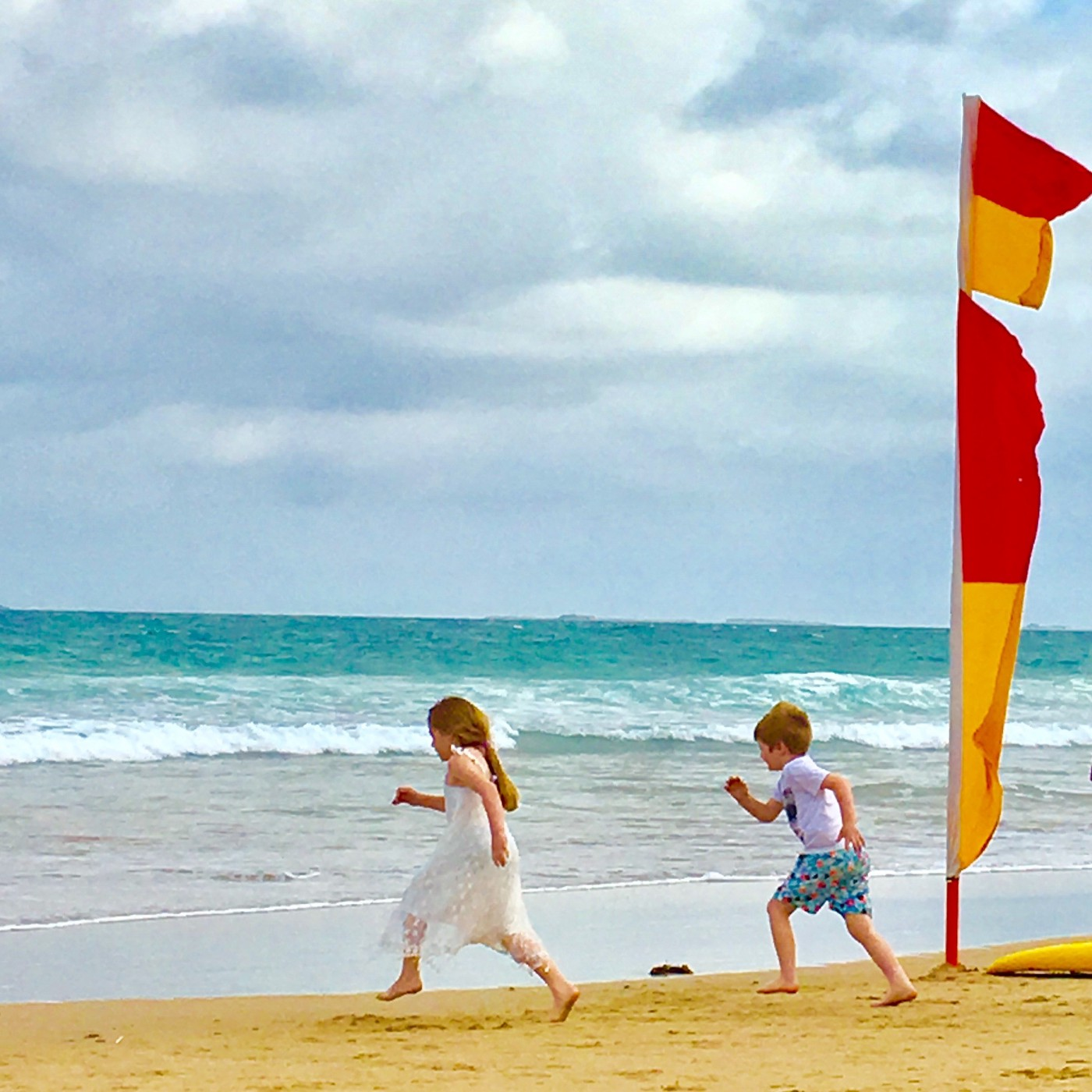 Children playing freely on the beach