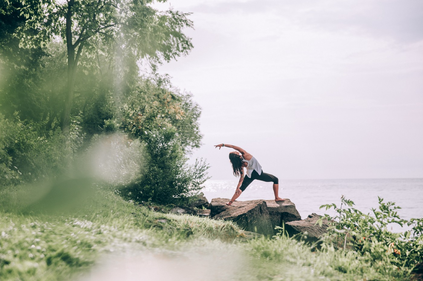 Photograph of a woman practicing yoga outdoors