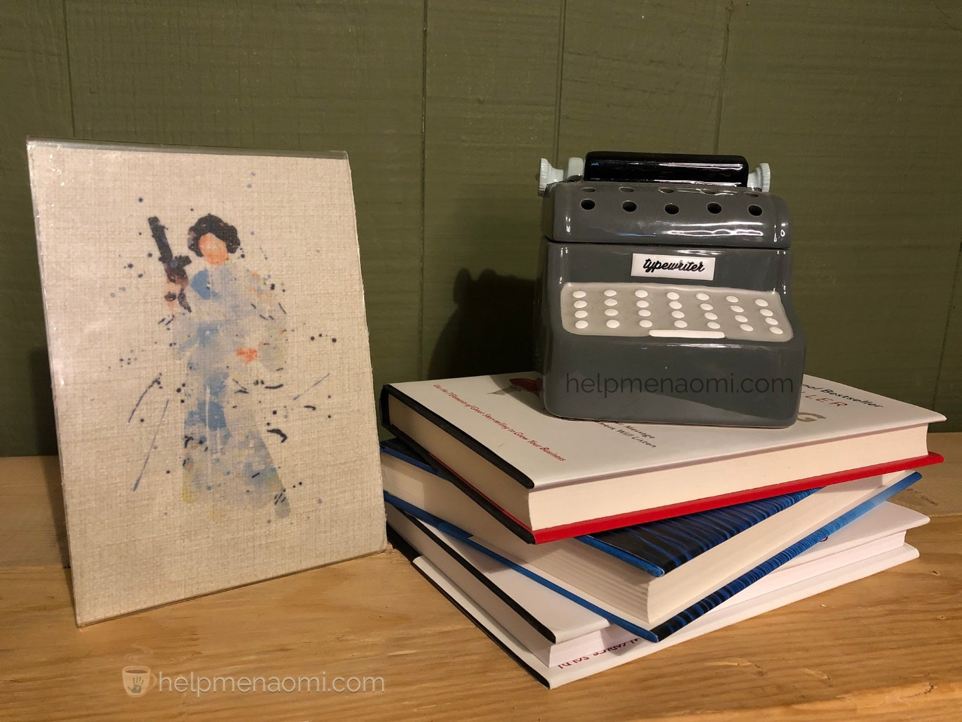 Princess Leia Burlap painting next to a stack of books with a miniature typewriter on top