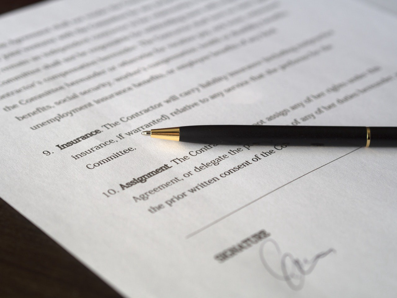 unsigned contract with a pen lying on it